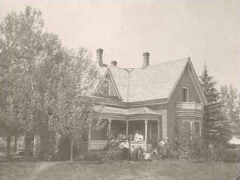 Front View of Stevens House with People on Porch