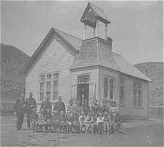 Upton School with students and teachers posed in front in black and white.